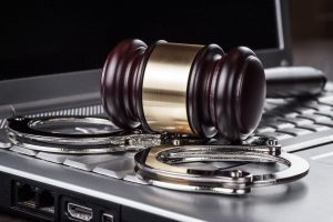 bigstock-handcuffs-and-judge-gavel-on-c-45589036